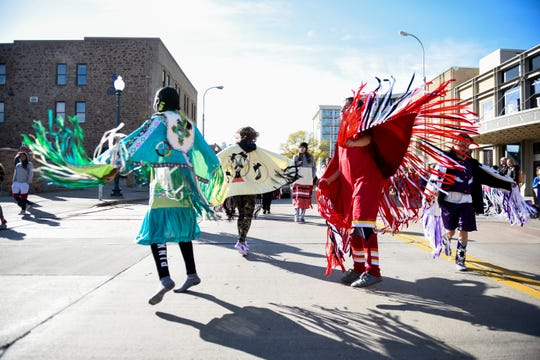 "Members of the Washington High School Okichiyapi Club dance during the Native American Day parade on Monday, Oct. 14, 2019. This years theme was ""Celebrating Our History: Inspiring the Future."""