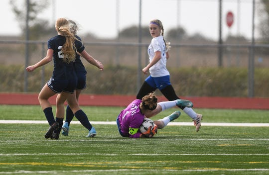 St. Thomas More goalie blocks Logan Pokorny blocks a Tea goal during the girls' semifinals on Monday, Oct. 14, 2019.