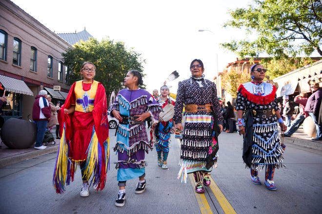 """Traditional jingle dancers participate in the Native American Day parade on Monday, Oct. 14, 2019. This years theme was """"Celebrating Our History: Inspiring the Future."""""""