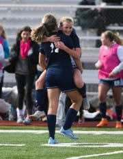Tea celebrates a win against St. Thomas More during the girls' semifinals on Monday, Oct. 14, 2019. The final score was 2-1.