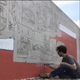 Art mural going up on 150-foot parking ramp wall in downtown Sioux Falls