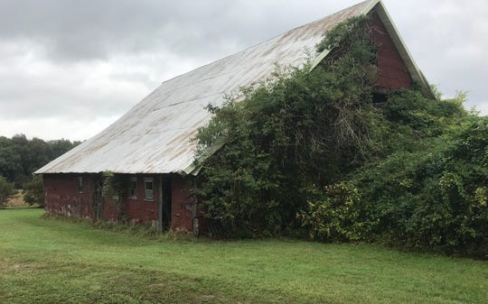 Two lawmen who had been hiding behind two trees for safety dashed for safety behind this barn, which is still on the property where the Young Brothers Massacre occurred in 1932.