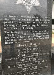 "This memorial stands outside the Circuit Courthouse on North Boonville Avenue.  The monument makes reference to ""Jennings and Harry Young and their outlaw gang.""  Although one police survivor, Frank Pike, believed there were as many as four shooters in the farmhouse, most believe it was only Jennings and Harry Young."