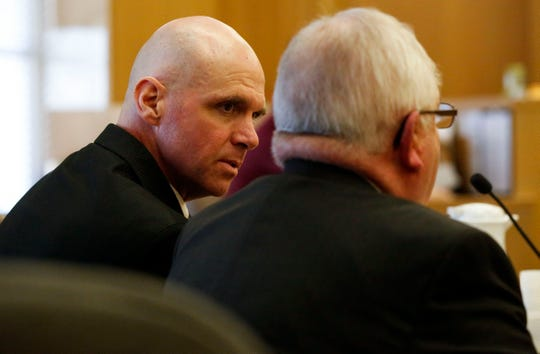 Jason Sypher consults with defense attorney Gary Kryshak during his trial on Monday, October 14, 2019, at the Portage County Courthouse in Stevens Point, Wis. Sypher is accused of murdering his wife, Krista Sypher, who went missing in March 2017 and has not been found.Tork Mason/USA TODAY NETWORK-Wisconsin