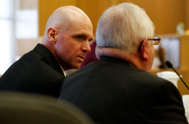 Jason Sypher consults with defense attorney Gary Kryshak during his trial on Monday, October 14, 2019, at the Portage County Courthouse in Stevens Point, Wis. Sypher is accused of murdering his wife, Krista Sypher, who went missing in March 2017 and has not been found.