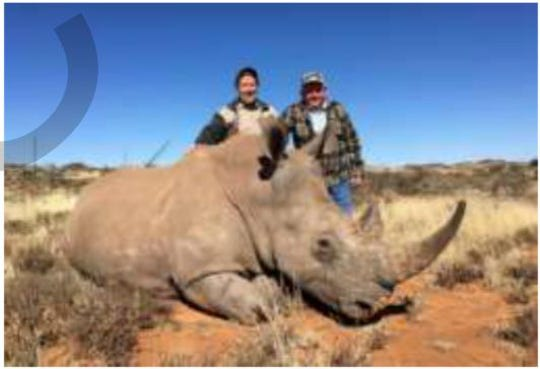Robert Quam, former DCF chief of administration for mental health facilities, and Richard Frey, general manager at Aramark, standing over dead Rhino shot in Africa in 2018.