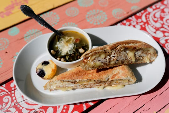 "The menu at Jeri's Midtown Cafe includes a sandwich called ""The 'TAB,'"" which includes sliced roasted turkey, apple butter, and Il de France brie on a Tribeca Demi baguette, served here with a cup of the restaurant's collard soup."