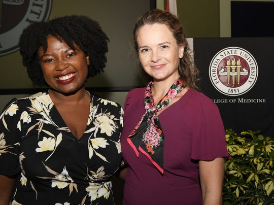 Fourth-year student Kharian Burnett-Foster, left, and Melinda Harrell Johnson at the Fort Pierce Regional Campus of Florida State University College of Medicine. Burnett-Foster received a $5,000 scholarship in memory of Dr. James Harrell, Melinda's father, and Dr. Maghraj Thanvi.