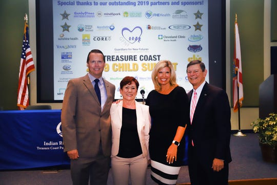 Indian River State College Dean Evan Barry, left, Guardians for New Futures Executive Director Debbie Butler, Morgridge Family Foundation Vice President Carrie Morgridge and IRSC President Dr. Edwin Massey at the 2019 Child Summit on Sept. 25-26, 2019.