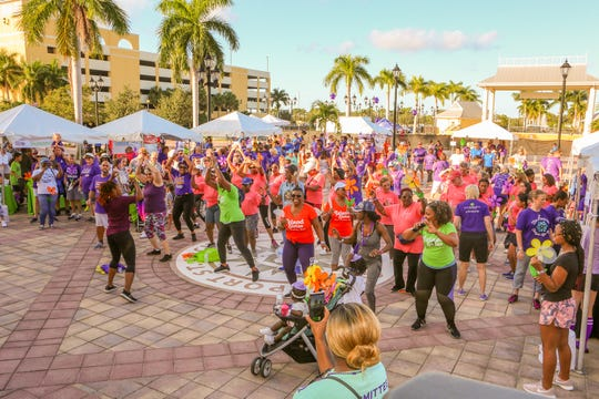 Participants warm up by doing Zumba before the Walk to End Alzheimer's at the Port St. Lucie Civic Center on Sept. 28, 2019.