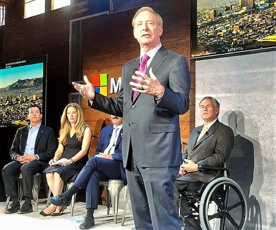 Microsoft President Brad Smith talks about El Paso-Juarez TechSpark program at Monday event at the EPIC Railyard event center in El Paso. Texas Gov. Greg Abbot, right, and Chihuahua Gov. Javier Corral, partially hidden, and other leaders share the stage with him.