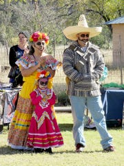 A family enjoyed a Dia de los Muertos event last year in Lincoln, N.M.