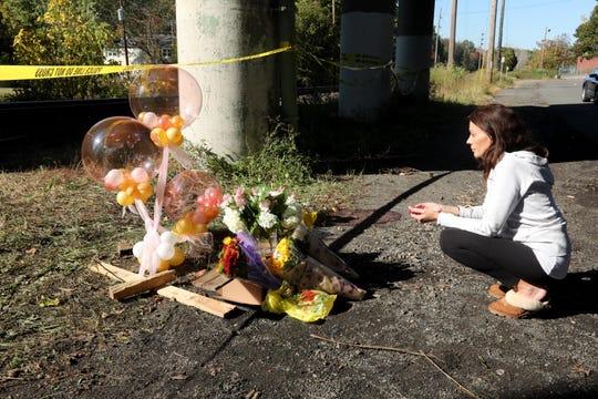Nana Kolenovic of Orangeburg, cousin of the two girls involved in Sunday's fatal crash in Pearl River, prays at the site of the crash Oct. 14, 2019.
