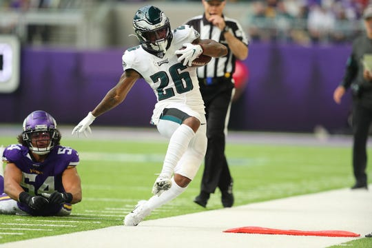 Miles Sanders (26) of the Philadelphia Eagles gets pushed out of bounds by Eric Kendricks (54) of the Minnesota Vikings in the second quarter at U.S. Bank Stadium on Sunday, Oct. 13, 2019 in Minneapolis.
