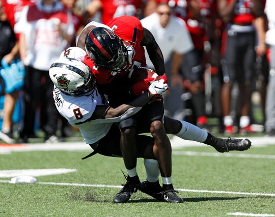 Oklahoma State's Rodarius Williams (8) tackles Texas Tech's T.J. Vasher (9) during the first half of an NCAA college football game Saturday, Oct. 5, 2019, in Lubbock, Texas. (AP Photo/Brad Tollefson)