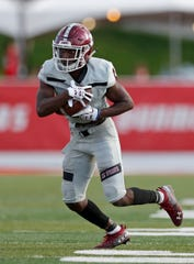New Mexico State wide receiver OJ Clark rushes to the end zone during the second half of an NCAA college football game against New Mexico on Saturday, Sept. 21, 2019 in Albuquerque, N.M. (AP Photo/Andres Leighton)