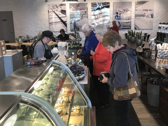 Customers order lunch at the café inside the retail shop at LaClare Family Creamery in Fond du Lac County. The area was reopened to the public on May 22 with social distancing guidelines and upgraded sanitary standards.