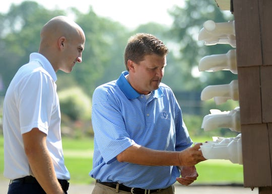 Maysville grad Chad Bucci, right, talks with Marion Country Club employee Kenton Comstock in 2010. Bucci, the former head pro at MCC, will be inducted into the Zanesville District Golf Association Hall of Fame on Wednesday.