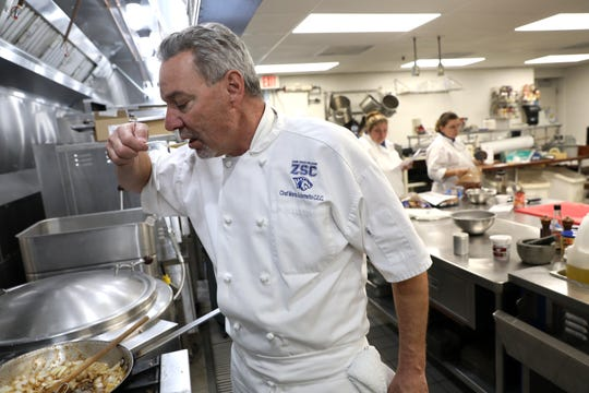 Marco Adornetto samples a dish in the culinary arts classroom at Zane State College. Adornetto was trained as a chef in New York, and now is the program director for the college.