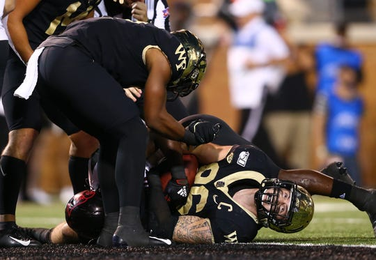 Wake Forest tight end Jack Freudenthal (86) checks for a touchdown signal during the fourth quarter against Louisville at BB&T Field.
