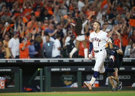 Game 2 - Astros shortstop Carlos Correa celebrates his walk-off home run.