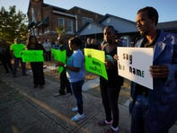 Protesters gather outside the house where Atatiana Jefferson was shot and killed by Fort Worth, Texas, police during a community vigil on Sunday night.