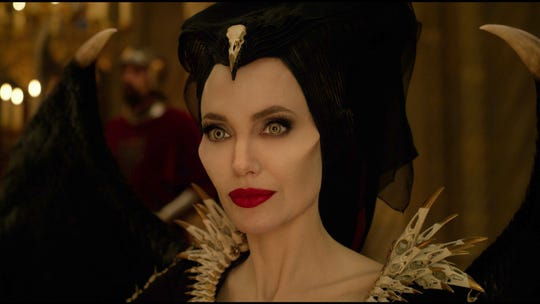 Angelina Jolie shows off her Maleficent power collar.
