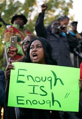 "Carol Harrison-Lafayette protests the police shooting of Atatiana Jefferson during a community vigil for Jefferson on on Oct. 13, 2019, in Fort Worth, Texas. A white police officer who killed the black woman inside her Texas home while responding to a neighbor's call about an open front door ""didn't have time to perceive a threat"" before he opened fire, an attorney for Jefferson's family said."