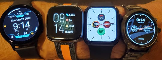 A wristful of watches, left to right: Samsung Galaxy Watch Active2, Fitbit Versa 2, Apple Watch Series 5, Fossil Gen 5.