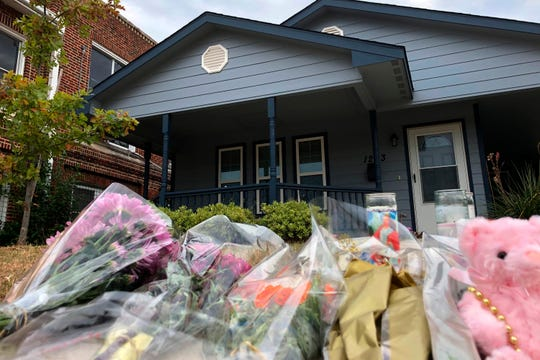 Bouquets of flowers and stuffed animals pile up Oct. 14, 2019, outside the Fort Worth home where Atatiana Jefferson, 28, was shot to death by a police officer.