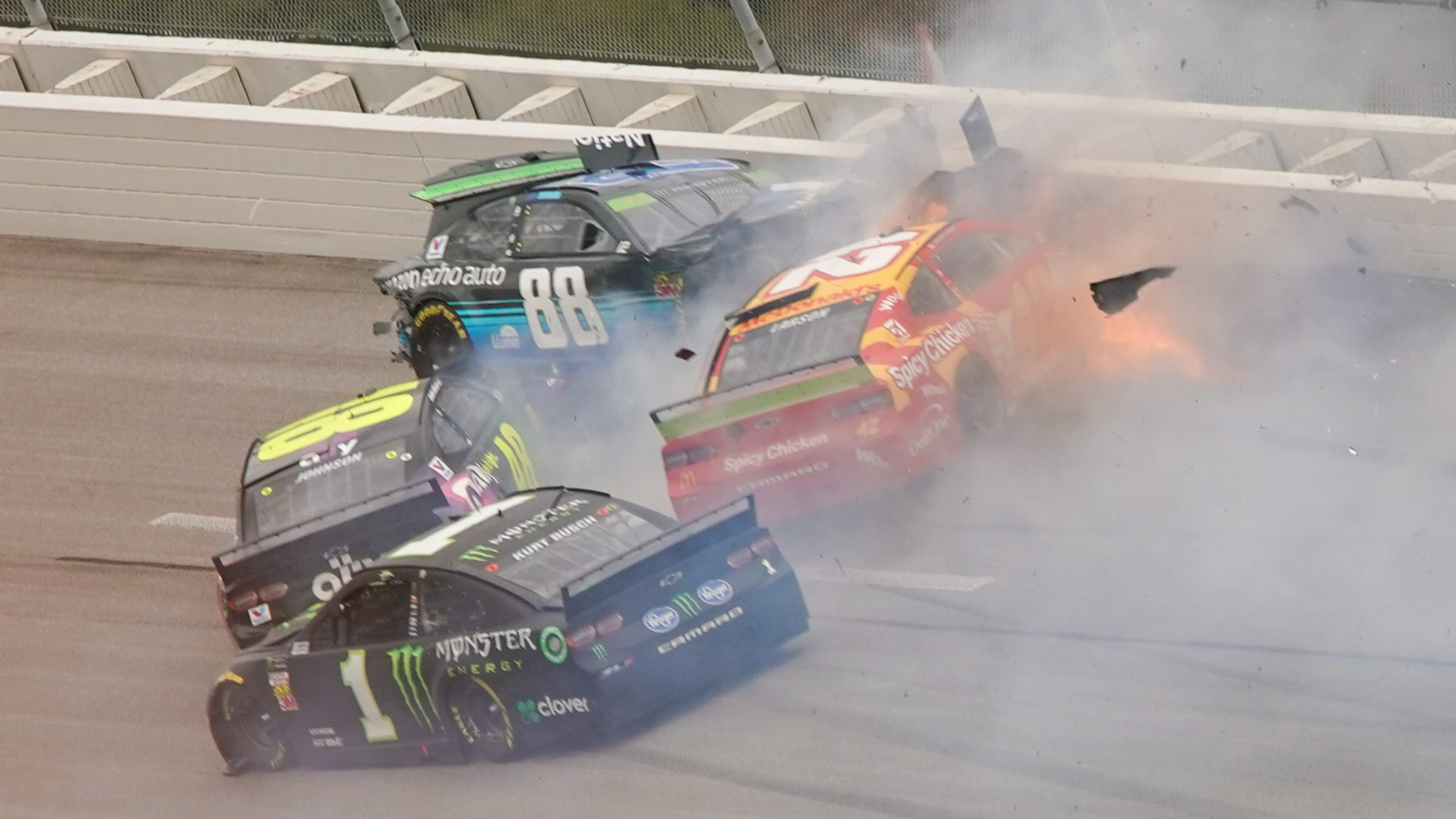 Ryan Blaney wins in a photo finish as crashes decimate the field at Talladega playoff race
