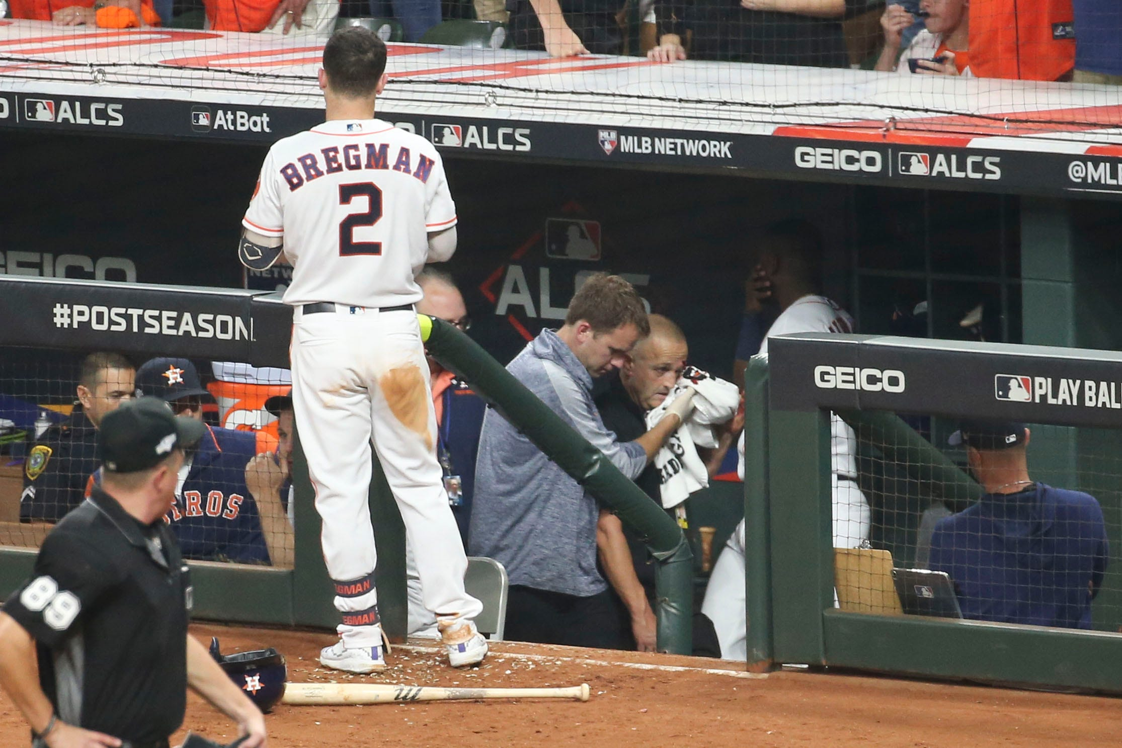 Foul ball drills paramedic in the Astros dugout during Game 2 of the ALCS