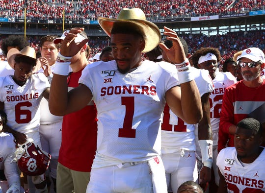 Oklahoma quarterback Jalen Hurts (1) wears the Golden Hat trophy after the Sooners defeated Texas at the Cotton Bowl.