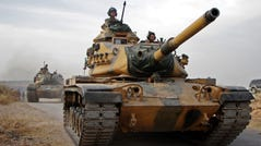 Turkish soldiers with US-made M60 tanks drive through the town of Tukhar, north of Syria's northern city of Manbij, on October 14, 2019, as Turkey and it's allies continues their assault on Kurdish-held border towns in northeastern Syria.