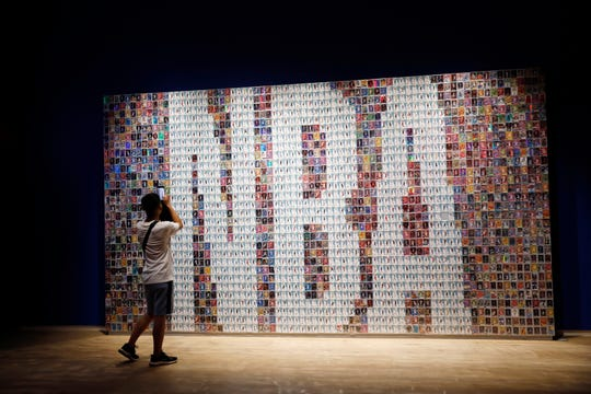 A mural made up of basketball player cards at the NBA exhibition in Beijing, China, in August 2019.