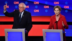 """(FILES) In this file photo taken on July 30, 2019 Democratic presidential hopeful US Senator from Massachusetts Elizabeth Warren (R) speaks next to US senator from Vermont Bernie Sanders during the first round of the second Democratic primary debate of the 2020 presidential campaign season hosted by CNN at the Fox Theatre in Detroit, Michigan. - Democrats seeking to oust climate skeptic Donald Trump from the White House are placing the """"existential threat"""" of a warming planet front and center for the 2020 presidential contests. With a rampaging Hurricane Dorian not far from the minds of many Americans, 10 Democratic presidential hopefuls have unveiled detailed plans of action on climate change. There were fissures on issues like nuclear energy, which proved particularly divisive. A split emerged between the popular two progressives, Sanders and Senator Elizabeth Warren, over the role of government in public utilities. (Photo by Brendan Smialowski / AFP)BRENDAN SMIALOWSKI/AFP/Getty Images ORIG FILE ID: AFP_1K19TI"""