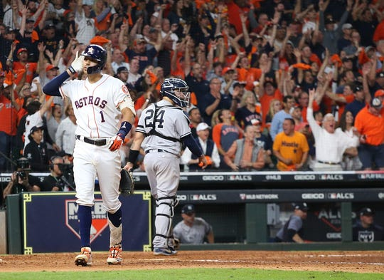 Carlos Correa celebrates after smacking a walk-off home run to lift the Houston Astros to a 3-2 victory in Game 2 of the ALCS vs. the New York Yankees.