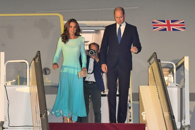 Prince William and Duchess Kate of Cambridge arrive at Pakistani Air Force Base Nur Khan on Oct. 14, 2019 in Rawalpindi, Pakistan, to start a five-day visit.