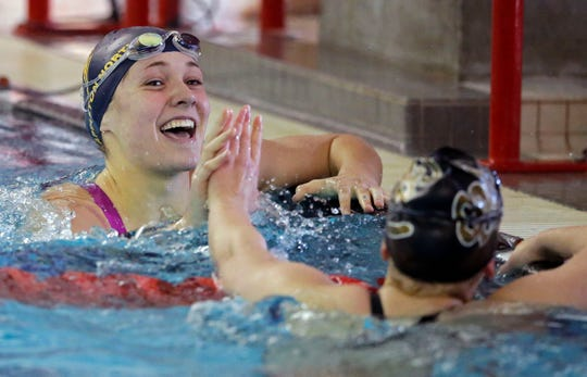 Joy Vandenberg, left, of Appleton North and Annabelle Metzler of Green Bay Southwest congratulate each other at the finish of the 50-yard freestyle at the WIAA Division 1 swimming sectional last November in Neenah.
