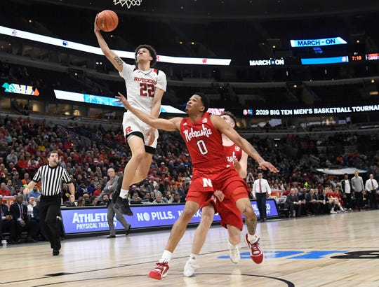 Rutgers Scarlet Knights guard Caleb McConnell (22) shoots the ball as Nebraska Cornhuskers guard James Palmer Jr. (0) defends during the Big Ten conference tournament last season. He started in place of Geo Baker Friday night.