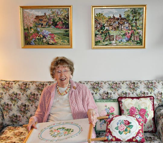 Barbara Potter, 94, of Applewood in Freehold, with some of her needlepoint pillows and art work.