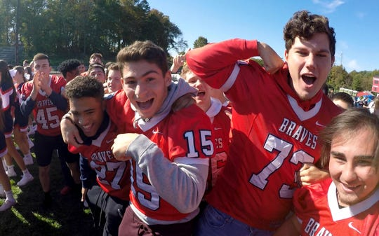 The Manalapan High School community gets fired up Tuesday, October 15, 2019, for the Red Zone Road Show and their game against Red Bank Catholic Friday night.