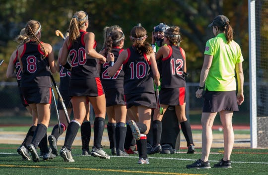 Jackson Memorial Millie Trembley gets mobbed by teammates after she knocked away a penalty shot during first half action. Point Pleasant Boro field hockey vs Jackson Memorial in SCT quarterfinal game in Point Pleasant Borough NJ on October 15, 2019.