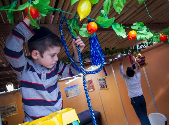 The Basser family of Lakewood hosted the Press as they decorated their sukkah prior to what many in the Orthodox community call the most joyous holiday of the year.