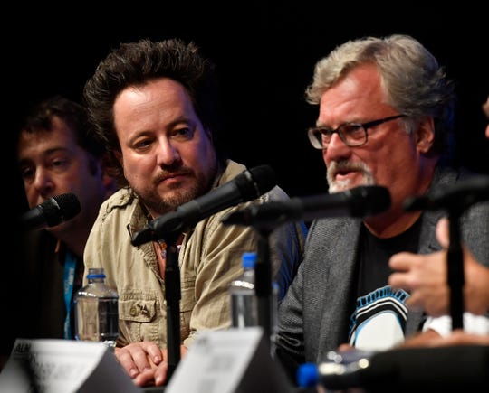 Giorgio Tsoukalos listens to David Childress during a panel discussion at AlienCon Dallas Oct. 6. Tsoukalos is a co- executive producer for the History channel's Ancient Aliens television show.