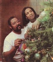 Odis Dolton with his wife, Pamela decorating a Christmas tree in December 1995.