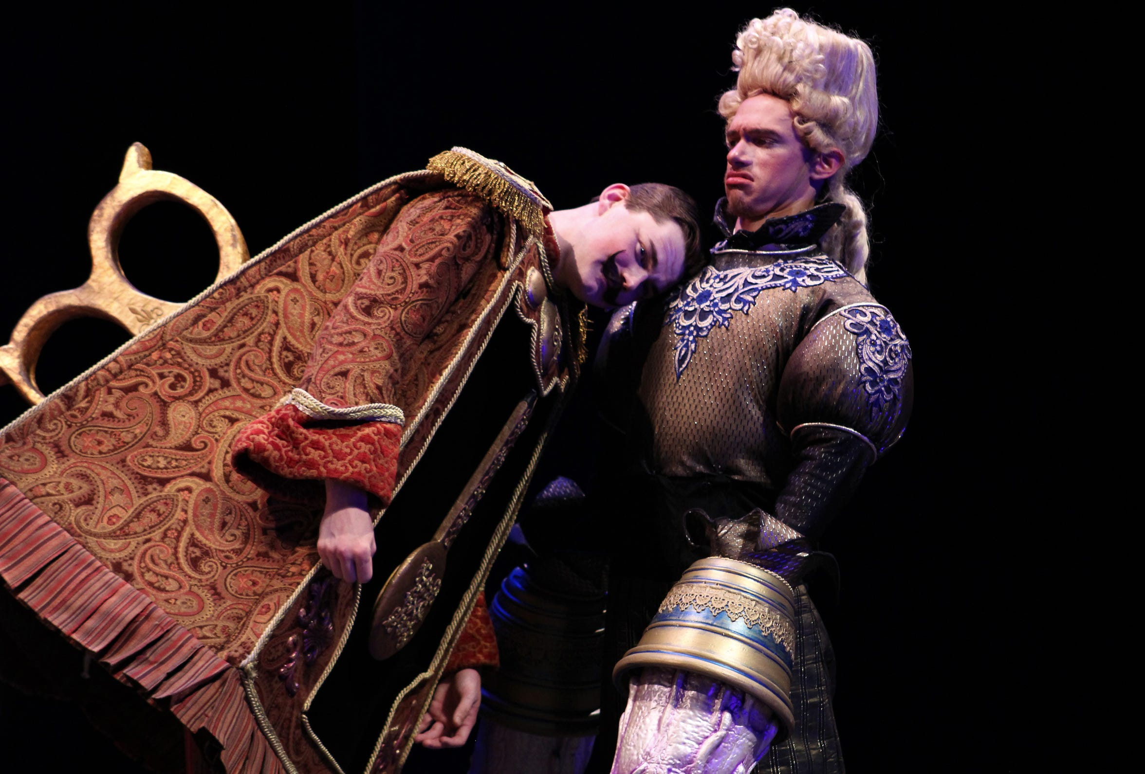 Cogsworth (Parker LeRoy, left), finds a shoulder to lean, that of Lumiere (Tre McLeod) as they ponder their enchanted lives.