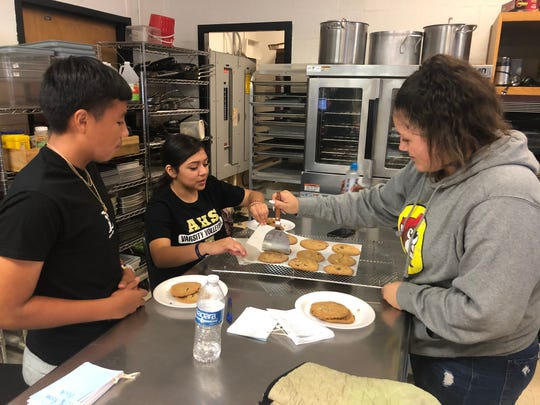 Sara Galvan, right, dishes out brown butter chocolate chip cookies she and classmates Marvel Coronado, left, and Sierra Orona made in culinary arts class at Abilene High School on Tuesday. Once the Abilene ISD's new The LIFT Center opens in 2021-22, programs such as culinary arts and other career and technical education courses will move to the new facility.