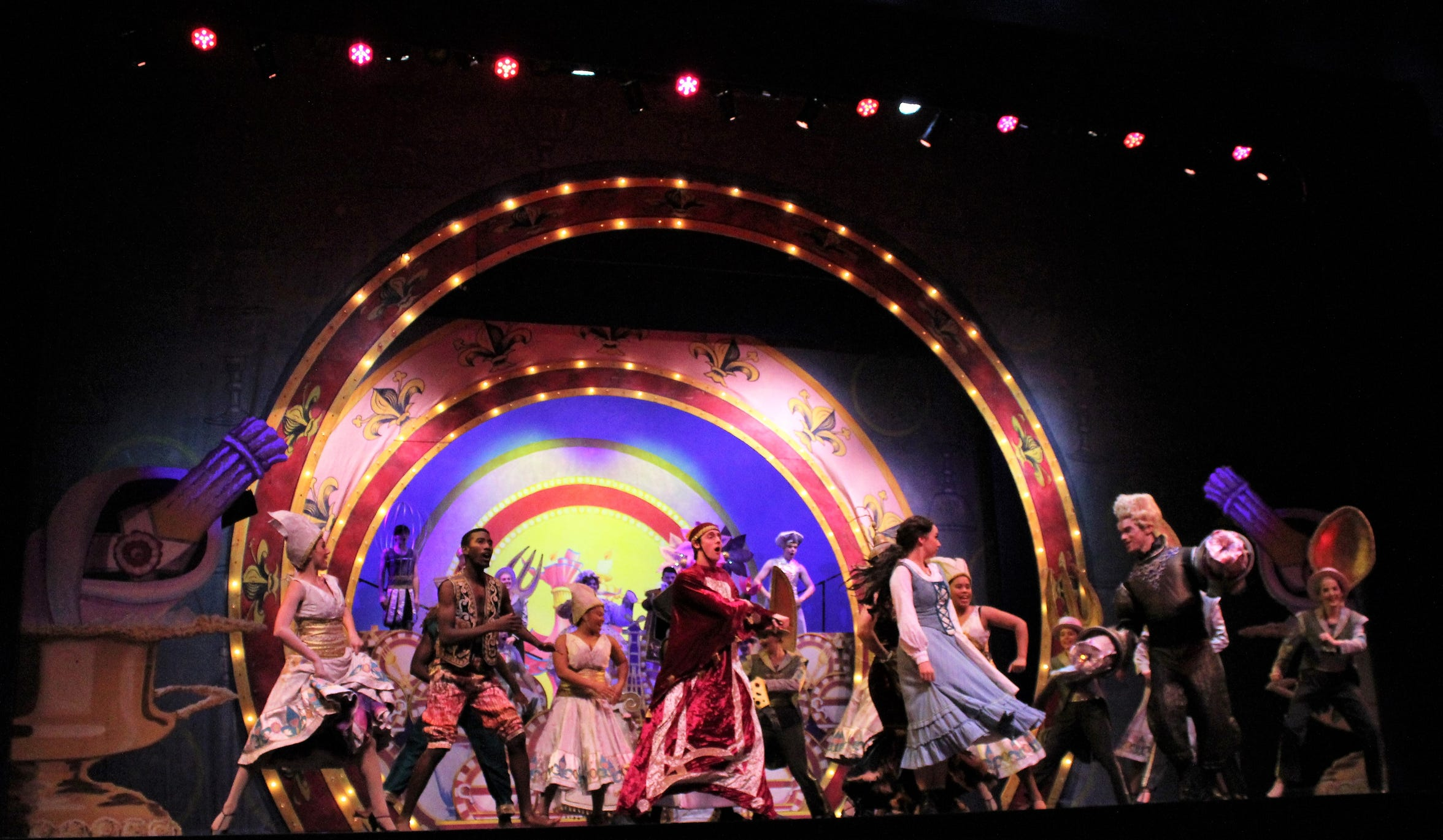"""""""Be Our Guest"""" is a highlight of """"Beauty and the Beast,"""" showcasing singing, creative costumes and Abilene Christian's newfound dancing talents. The homecoming musical will be performed three times this weekend at the Abilene Convention Center."""