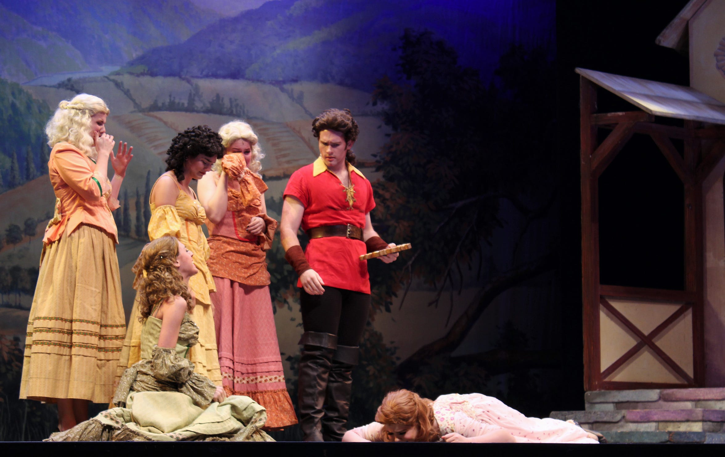 """Gaston (Griffin Jones) is after Belle but at least five young women literally are falling for him in Abilene Christian University's production of """"Beauty and the Beast."""""""